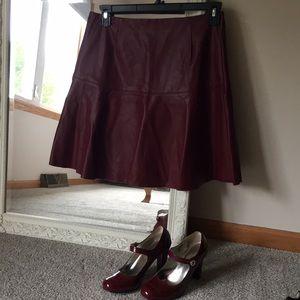 Burgundy flare skirt.